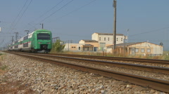 Commuter train passes quickly Stock Footage