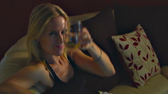 Sexy Blonde Woman with attitude and wine toasts to cam  Stock Footage