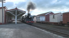 Steam train pulls into old station Stock Footage