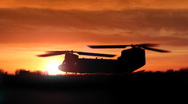 Stock Video Footage of Chinook twin-blade helicopter lifts off