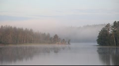 Morning on wild forest lake in Karelia, Russia Stock Footage