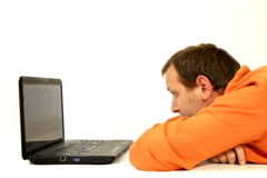Man watching movie on laptop, isolated Stock Footage