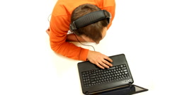 Man with headphones working on laptop, top view, isolated Stock Footage