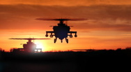 Stock Video Footage of Apache AH-64 Gunship Helicopters Rising Over Ridge