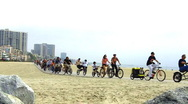Stock Video Footage of Parade of Bicycles at the Beach