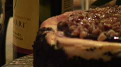 Cheesecake Rack Focus from Wine Bottle Stock Footage
