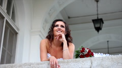Beautiful bride sends a kiss and smile - stock footage