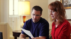 Budget and Bill Review by Young Couple Stock Footage