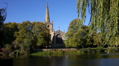 Stock Video Footage of Holy Trinity Church beside the River Avon at Stratford upon Avon  Warwickshire
