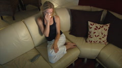 Pretty blonde woman crying watching TV / Movie Stock Footage