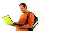 Male student with laptop, isolated Stock Footage