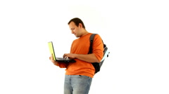 Male student with laptop smiling to camera, isolated Stock Footage