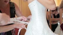 Bride getting dressed Stock Footage