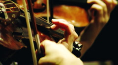 People musicians playing violins in the orchestra of the theater - stock footage