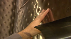 Pointing out dimples on steel wine tank Stock Footage
