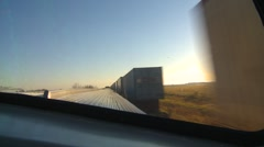 Railroad, passing sea-container train from dome car Stock Footage