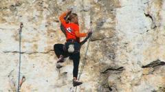 Climbing Woman Stock Footage