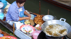 Women Cook on Thai river boat Stock Footage