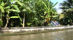 Cruising past Thai shrine Stock Footage