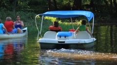 Children in a paddle boat (HD) m Stock Footage