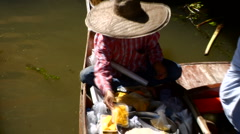 Thai woman sells food from boat at water market  Stock Footage