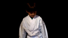 Kid in karate outfit Stock Footage