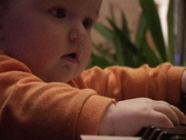 Baby playing with piano Stock Footage