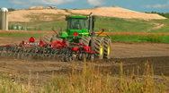 Tractor plowing the fields  Stock Footage