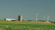 Wind turbines over an agricultural field   Stock Footage