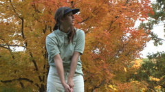 Female golfer on an autumn day (1 of 3) - stock footage