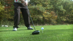 Amateur golfer takes a swing - stock footage