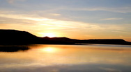 Sunrise on morning lake with mountain Stock Footage