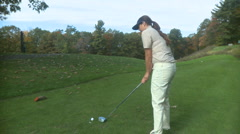 Female golfer drives from the tee box (front view) - stock footage