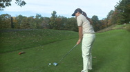 Stock Video Footage of Female golfer drives from the tee box (front view)