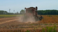 Michigan farmers harvesting soybean field with a combine Stock Footage