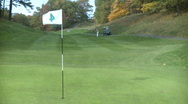 Stock Video Footage of Golfer sends the ball 125 yards to the green