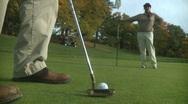 Golfer attempts short putt (1 of 2) Stock Footage
