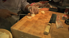 Sushi chef slicing scallops Wide Stock Footage