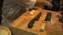 Sushi chef cleans cutting board as Sushi Bar Stock Footage