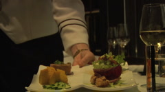 Waitress serves dinner to man at fancy restaurant Stock Footage
