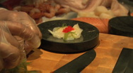 Stock Video Footage of Sushi chef garnishing scallop Sashimi