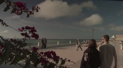Couple Walks Along Boardwalk - stock footage