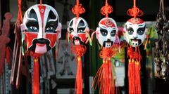 Beijing opera masks in chinese market Stock Footage
