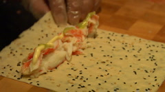 Sushi chef makes crab roll in rice paper  Stock Footage