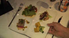 Waiter serves plate of asian food at fancy restaurant Stock Footage