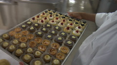 Tray of Cupcakes in industrial bakery kitchen Stock Footage