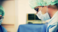 Surgeons operating iv bags Stock Footage