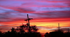 4K video 30p Red skies at night - telephone pole silhouette Arizona sunset Stock Footage