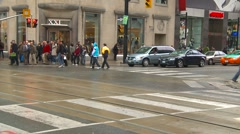 People crossing street in Toronto, wide shot Stock Footage