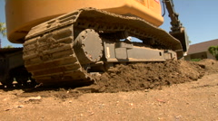 Excavator digging hole Stock Footage